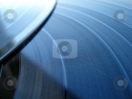 Two Records stock photo, Two LP records shine in the evening sunlight. by Ben O'Neal
