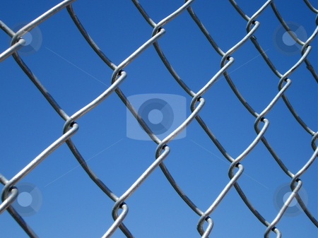 Chain Link Fence stock photo, A chain link fence shines in the afternoon sun. by Ben O'Neal