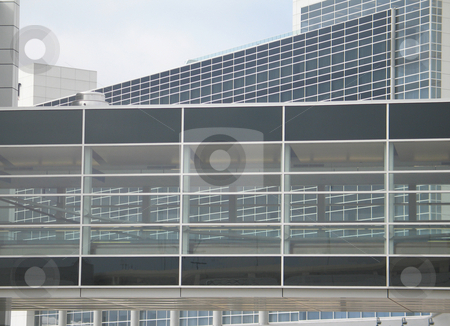 Glass modern building stock photo, Glass modern building by Mbudley Mbudley