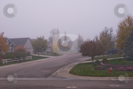 Quiet suburban neighborhood in the fall stock photo, Fog mutes the autumn colors on this suburban morning by RCarner Photography