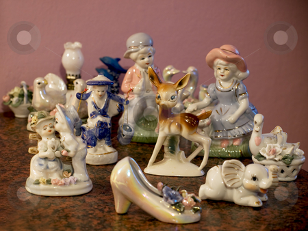 Ceramic figurines stock photo, Lot of porcelain or ceramic figurines in retro style. by Sinisa Botas
