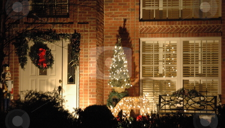 House Decorated for Christmas stock photo, Homes are often decorated on the outside for the Christmas holiday season. The decorations are often lighted for nightime viewing. by Janie Mertz