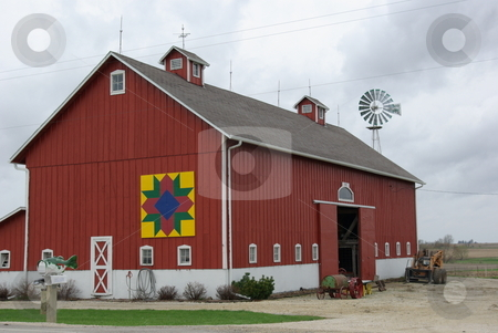 Barn Quilt on Old Iowa Barn stock photo, Barn Quilts are making an appearance on old barns in Iowa and other farm states.  They are generally 8'x 8