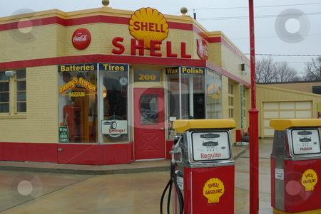 Old Shell Gas Station stock photo, This old Shell Gas Station on main street in Waverly, Iowa offers a step back in time to the 1970s when gas cost less than one dollar ($1) a gallon.  The old gas station, which has been restored with care to its sparkling former glory, is now a museum and is open on special occasions or by private appointment by Dennis Thomsen