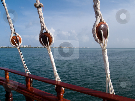 Romantic Cancun Bay Cruise stock photo, Looking over the rail toward shore during an evening dinner cruise. by Gary W. Sherwin