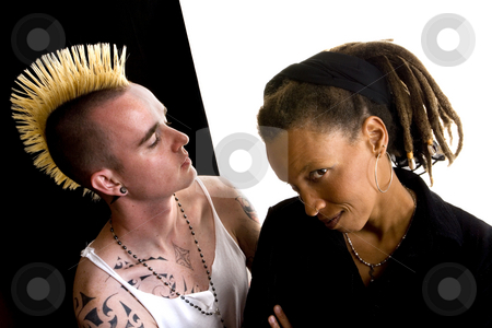 White Man and Black Woman stock photo, Portrait of white man with mohawk and black woman with dreadlocks by Scott Griessel