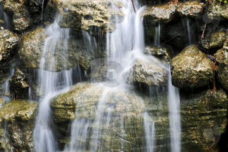 Waterfall over stones stock photo, Waterfall over natural stones in japanese zen garden by Elena Elisseeva