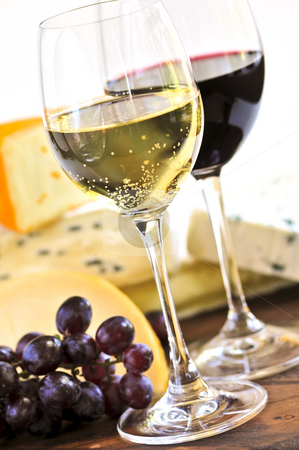 Wine and cheese stock photo, Wineglasses with red and white wine and assorted cheeses by Elena Elisseeva