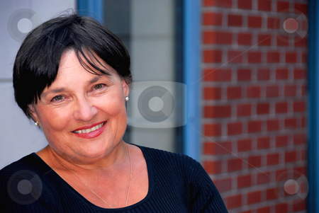 Businesswoman stock photo, Portrait of a mature business woman outside of office by Elena Elisseeva