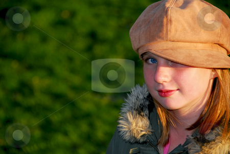 Girl portrait outside stock photo, Portriat of a young smiling girl in fall clothes outside by Elena Elisseeva