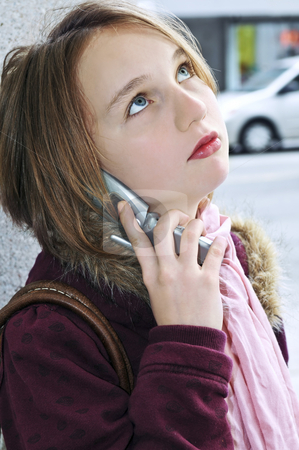 Teenage girl talking on cell phone stock photo, Teenage girl talking on cell phone outside by Elena Elisseeva
