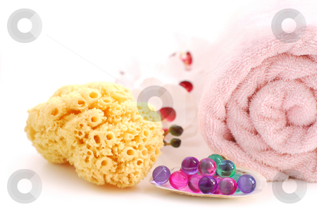 Spa stock photo, Pink rolled up towel with bath beads and natural sponge on white background by Elena Elisseeva