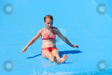 Girl water slide stock photo, Young girl goind down water slide by Elena Elisseeva