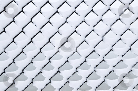 Link fence under snow stock photo, Pattern of chain link fence under fresh snow by Elena Elisseeva