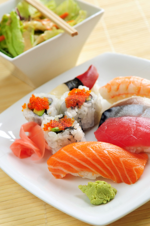 Sushi lunch stock photo, Lunch of assorted sushi and green salad by Elena Elisseeva