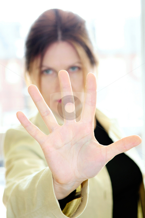Mature woman gesturing stop stock photo, Mature woman gesturing stop with palm of her hand by Elena Elisseeva