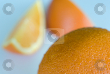 Orange segments stock photo, Orange segments on a cyan background by Stephen Gibson