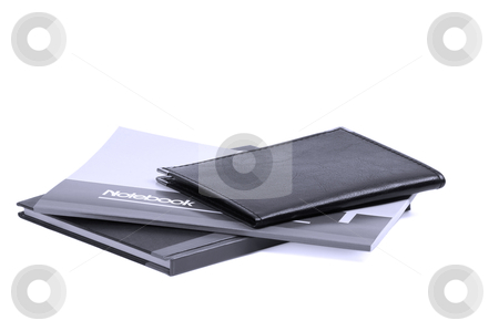Notebooks stock photo, Assorted notebooks flat piled on white background,blue filter by Francesco Perre