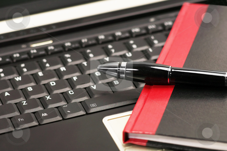Laptop and notebook stock photo, Laptop keyboard and notebook with fountain pen by Francesco Perre