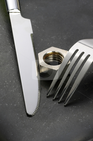 Hex nut on a plate stock photo, Hex nut on a black plate with knife and fork by Francesco Perre