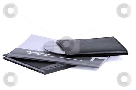 Notebooks stock photo, Assorted notebooks with a cd flat piled on white background,blue filter by Francesco Perre