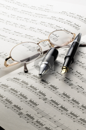 Music charts stock photo, Music charts with glasses and pen on top by Francesco Perre