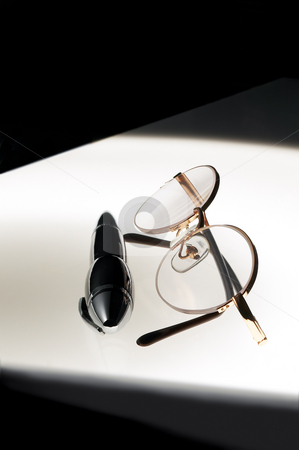 Pen and glasses stock photo, Pen and glasses over white glass table by Francesco Perre