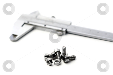Caliper and bolts stock photo, Caliper and bolts on white background by Francesco Perre