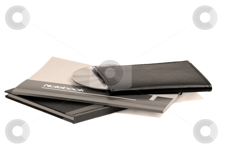 Notebooks stock photo, Assorted notebooks with a cd flat piled on white background,sepia filter by Francesco Perre