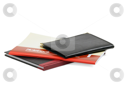 Notebooks stock photo, Assorted notebooks flat piled on white background by Francesco Perre