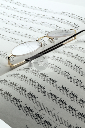 Music charts stock photo, Percussion and drums music charts with glasses on top by Francesco Perre