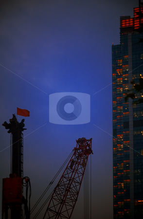 Construction cranes stock photo, Construction cranes on night ove a blue sky by Francesco Perre