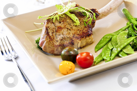 Veal dinner stock photo, Gourmet dinner of veal rib chop and vegetables by Elena Elisseeva