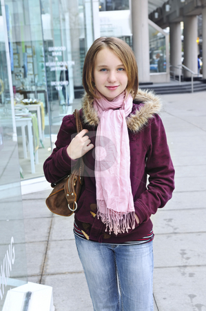 Teenage girl shopping stock photo, Teenage girl window shopping on city street by Elena Elisseeva