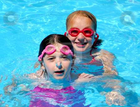Girls children pool stock photo, Two girls having fun in a swimming pool by Elena Elisseeva