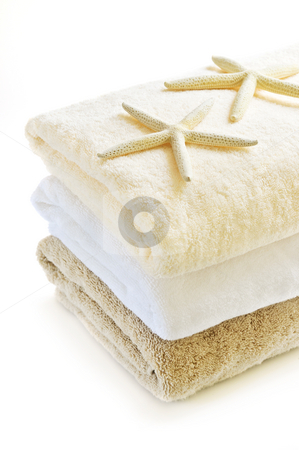 Stack of towels stock photo, Stack of soft towels isolated on white background by Elena Elisseeva