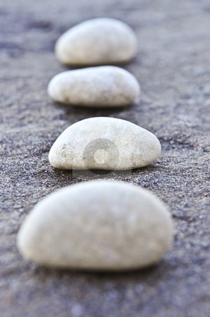 Stones stock photo, Small stones on a surface of big rock by Elena Elisseeva