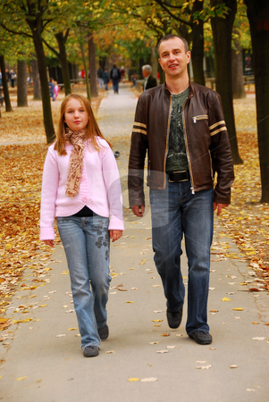 Father daughter walk stock photo, Father and daughter taking a walk in an autumn park by Elena Elisseeva