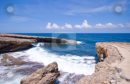Rocky shore inlet stock photo, Tropical shore inlet with nice waves by Karin Claus