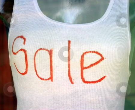 Sale Shirt stock photo, White undershirt with the text Sale written on it. by Henrik Lehnerer