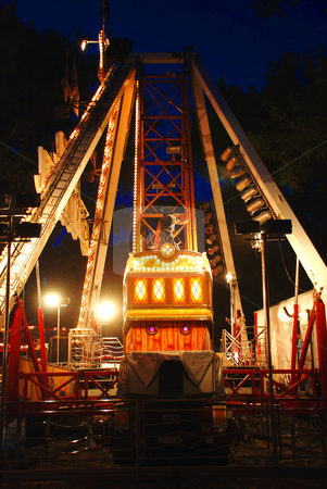 Carousel in evening park stock photo, Illuminated Construction of carousel in evening park by Julija Sapic