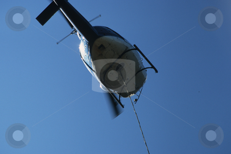 Logging Helicopter stock photo, Logging Helicopter With Long Line At Landing. by Mallorey Orcutt