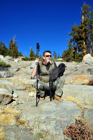 Hiker Rest Break stock photo, A single male day hiker taking a rest break while hiking in the California Sierra's by Lynn Bendickson