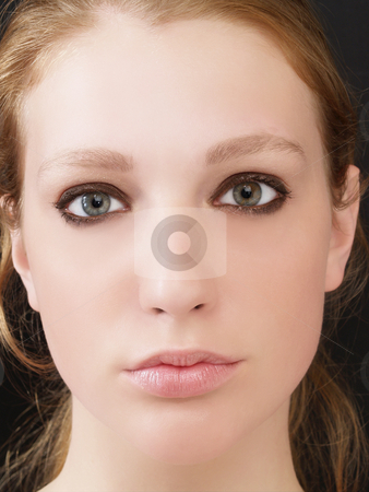 Closeup of pretty blond woman no smile stock photo, Portrait of pretty young blond woman with relaxed expression by Jeff Cleveland