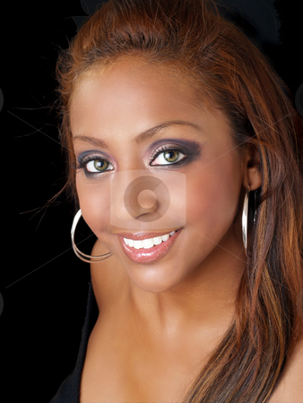 Portrait of happy smiling black woman stock photo, Young black woman portrait with pretty smile by Jeff Cleveland