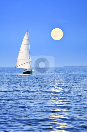 Sailboat at full moon stock photo, Sailboat sailing in a sea at full moon night by Elena Elisseeva