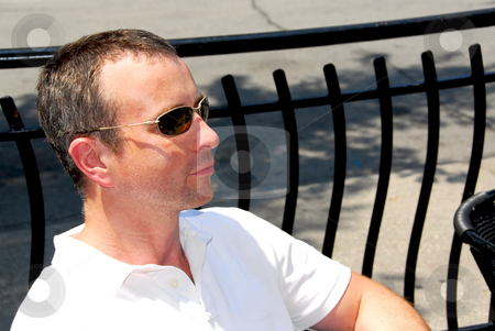 Man sunglasses stock photo, Portrait of a man wearing sunglasses in outdoor cafe by Elena Elisseeva