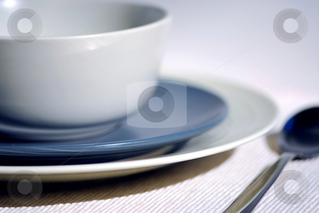 Plates stock photo, Dinner place setting with plates and soup bowl by Elena Elisseeva