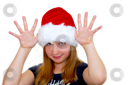 Christmas girl stock photo, Portrait of a young girl wearing Santa's hat isolated on white background by Elena Elisseeva
