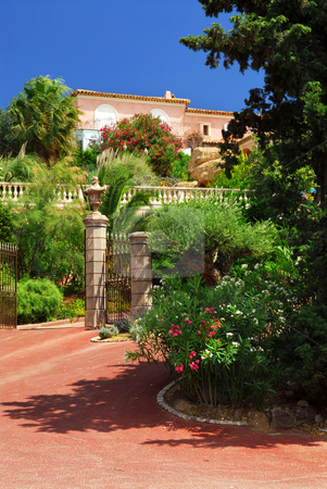 Lush garden in front of a villa stock photo, Lush garden in front of a villa on French Riviera by Elena Elisseeva